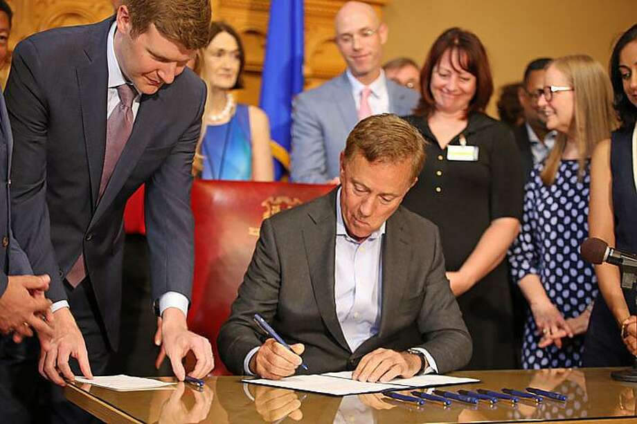 Gov. Ned Lamont signs a law Monday that seeks to end discrimination from insurance companies against those suffering with addiction and mental health disorders. Photo: Christine Stuart / CTNewsJunkie.com