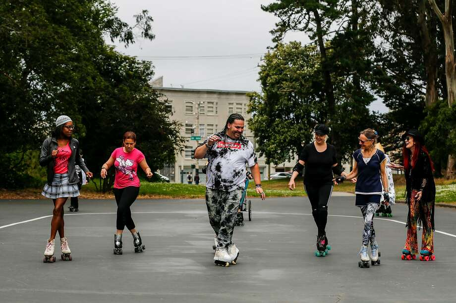 Luster Farias Jr. of Belmont (center) leads a line skate at the Skatin' Place in Golden Gate Park on July 7, 2019, during the weekly Sunday gathering of skaters. In 1979, a group of roller skaters known as the Skate Patrol stopped the City Hall attempt to ban skating in Golden Gate Park. Photo: Josie Norris / The Chronicle