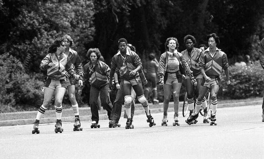 On Aug. 10, 1980: The Golden Gate Park Skate Patrol rolls through the park in matching tracksuits. Photo: Frederic Larson / The Chronicle 1980