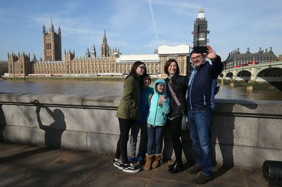 Top: Tourists take a selfie on the Thames River in London. All of Great Britain has fewer homeless on its streets, some 5,100, than does the city of S.F. Photo: Jonathan Brady / PA Images