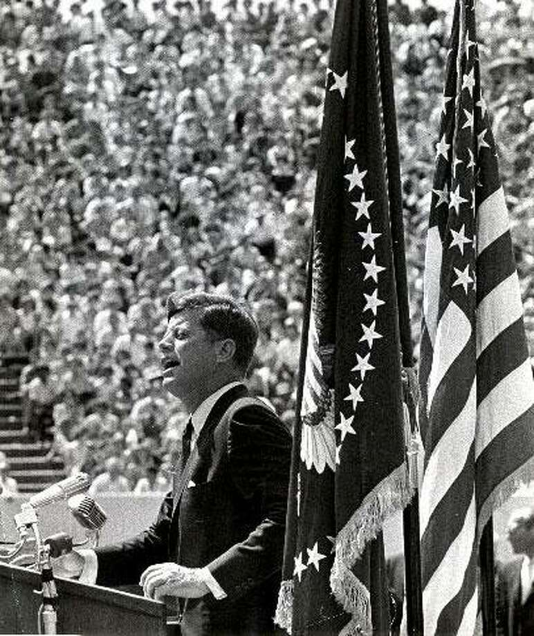 "09/12/1962 - President John F. Kennedy addresses a crowd at Rice Stadium in Houston. ""We Do Not Intend to Stay Behind in Space""."