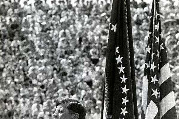"""09/12/1962 - President John F. Kennedy addresses a crowd at Rice Stadium in Houston. """"We Do Not Intend to Stay Behind in Space""""."""