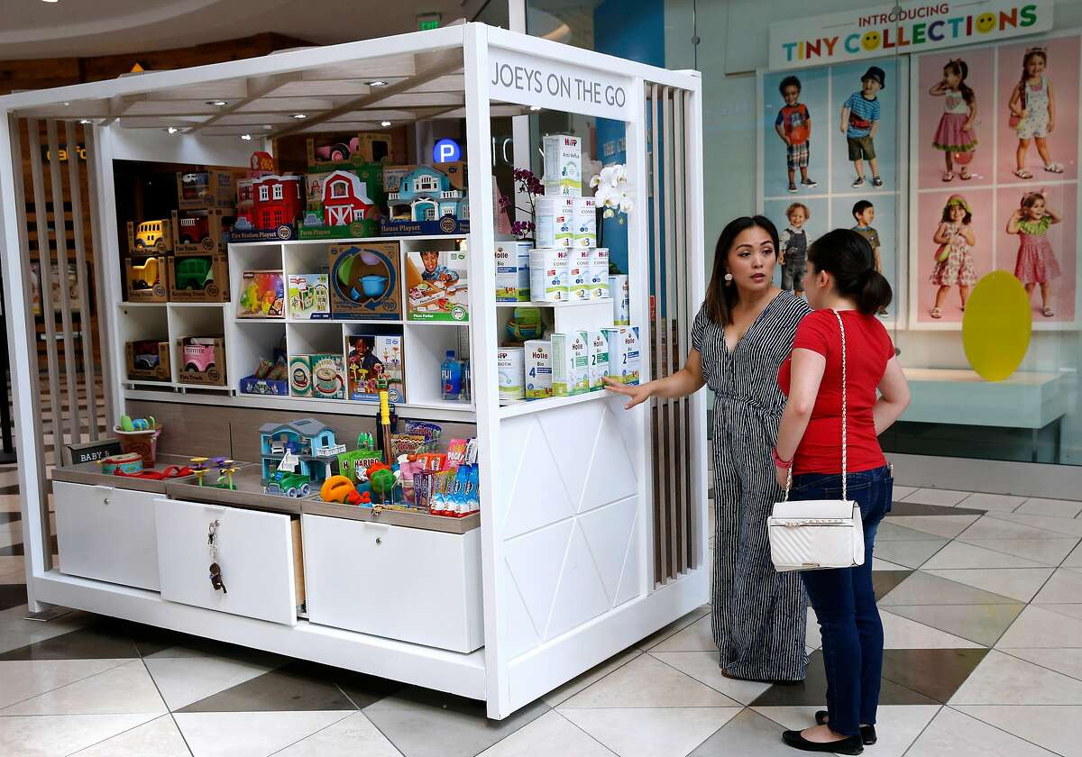 Nika Manabat (left) sells popular baby formula imported from Europe at her Joeys on the Go kiosk at Valley Fair Mall in Santa Clara, Calif. on Tuesday, May 7, 2019.