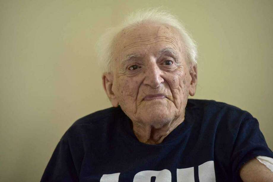 New Fairfield veteran Lou Russo during his 100th birthday party . Russo's experience with a court-appointed conservator after a fall in his home sparked a bill in the state legislature to better protect the elderly in similar situations. Saturday, August 4, 2018, in New Fairfield, Conn Photo: H. John Voorhees III