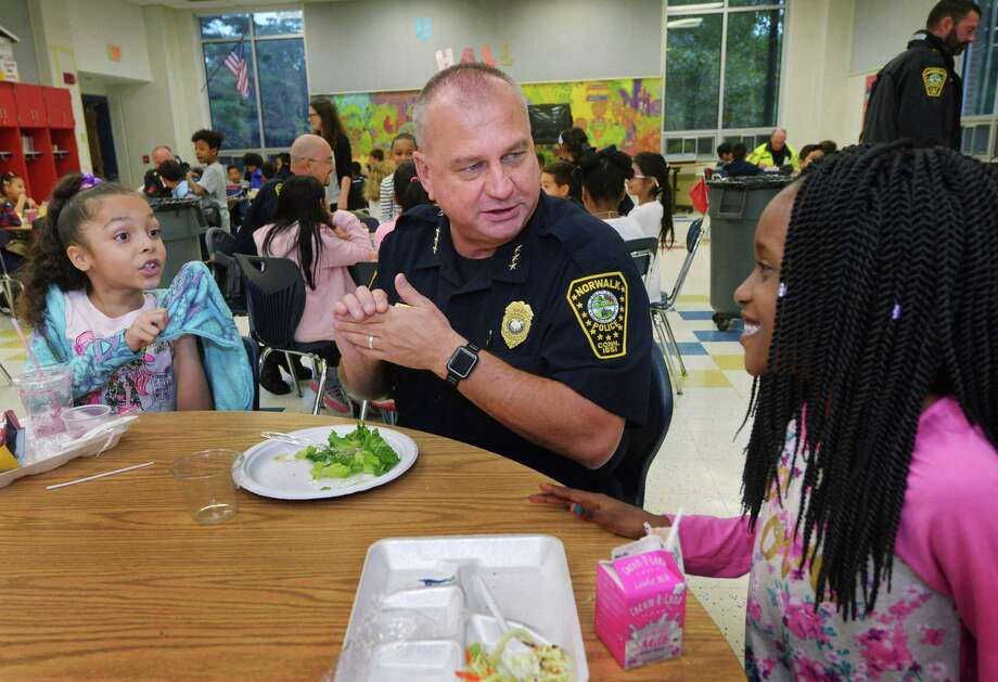 Norwalk Police Chief Thomas Kulhawik chats with 3rd graders Liliana Alvarez and Kendra Dorvalis during The 3rd annual First Responders' Luncheon Sept. 25 at Silvermine Dual-Language Magnet School in Norwalk. Norwalk firefighters, police officers, and EMTs visited the school to have lunch in the cafeteria with the students. Photo: Erik Trautmann / Hearst Connecticut Media / Norwalk Hour
