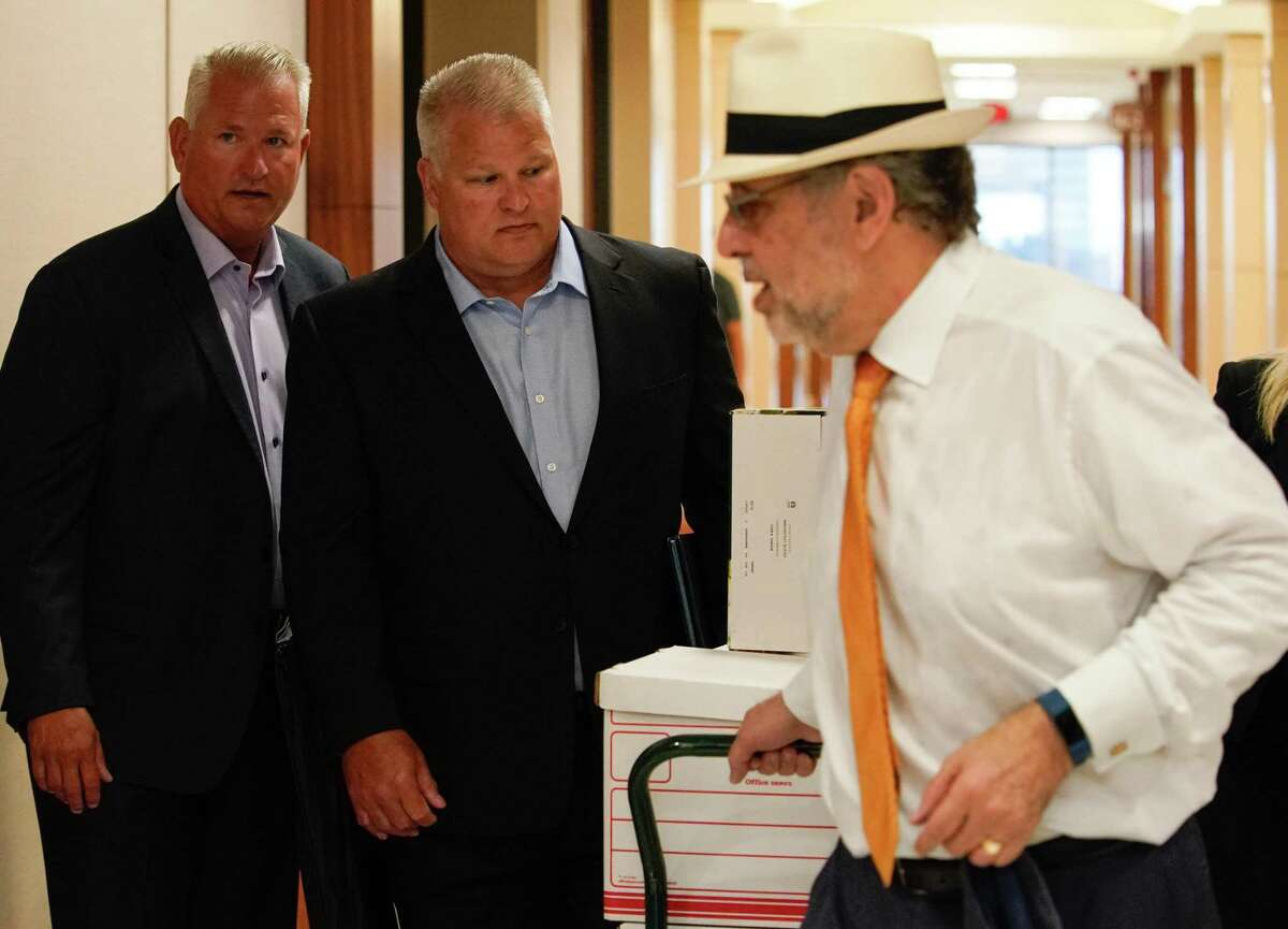 David Temple, center, arrives to court for his murder trial Monday, July 8, 2019 in Houston. He is accused of killing his wife, Belinda Temple, in January 1999. The former Katy-area football coach is standing trial for the second time in the case, after an appeals court reversed his guilty verdict because of prosecutorial misconduct.