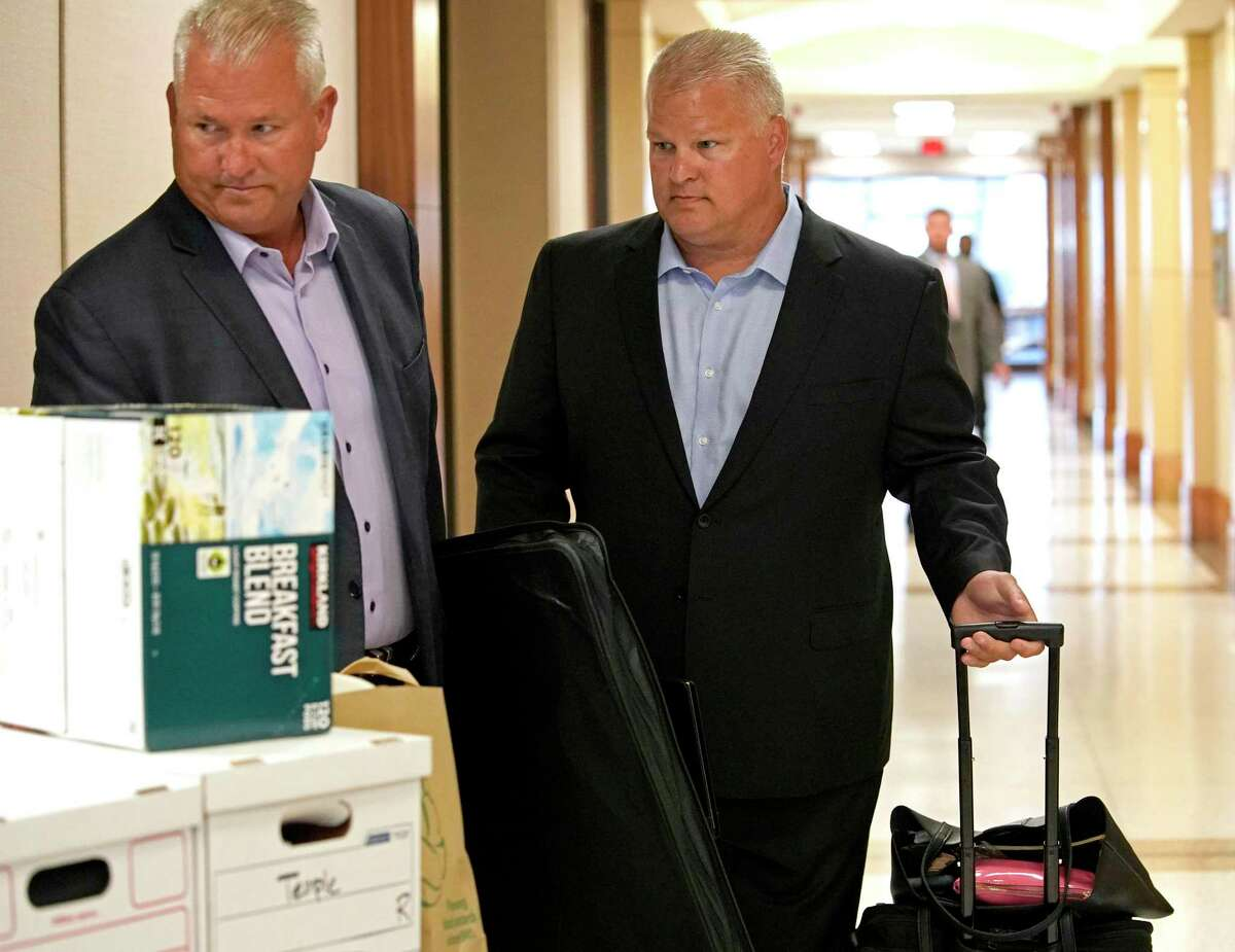 David Temple, right, arrvies to court for his murder trial in the 178th District Court Monday, July 8, 2019, in Houston. Temple is accused of killing his wife, Belinda Temple, in January 1999.