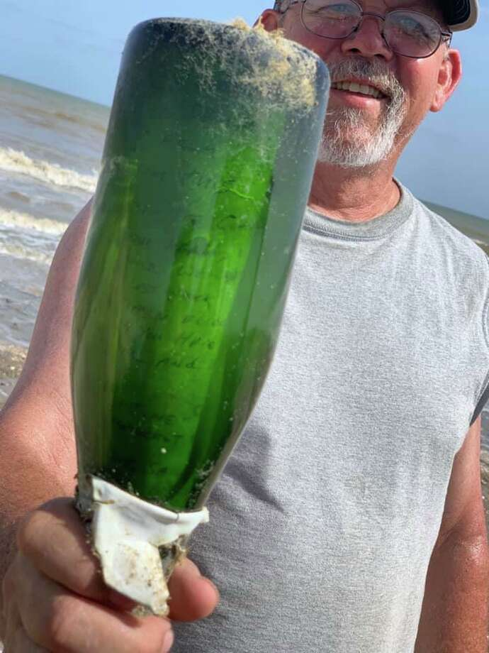 """James Howie Hill says on Friday, the group had been combing for several hours. That's when he spotted a green object that caught his eye.   """"I saw the bottle and it looked like it had something in it,"""" said Hill.  """"After wiping the dried algae off I saw the note and handwriting. We were all excited."""" Photo: James Howie Hill/Facebook"""