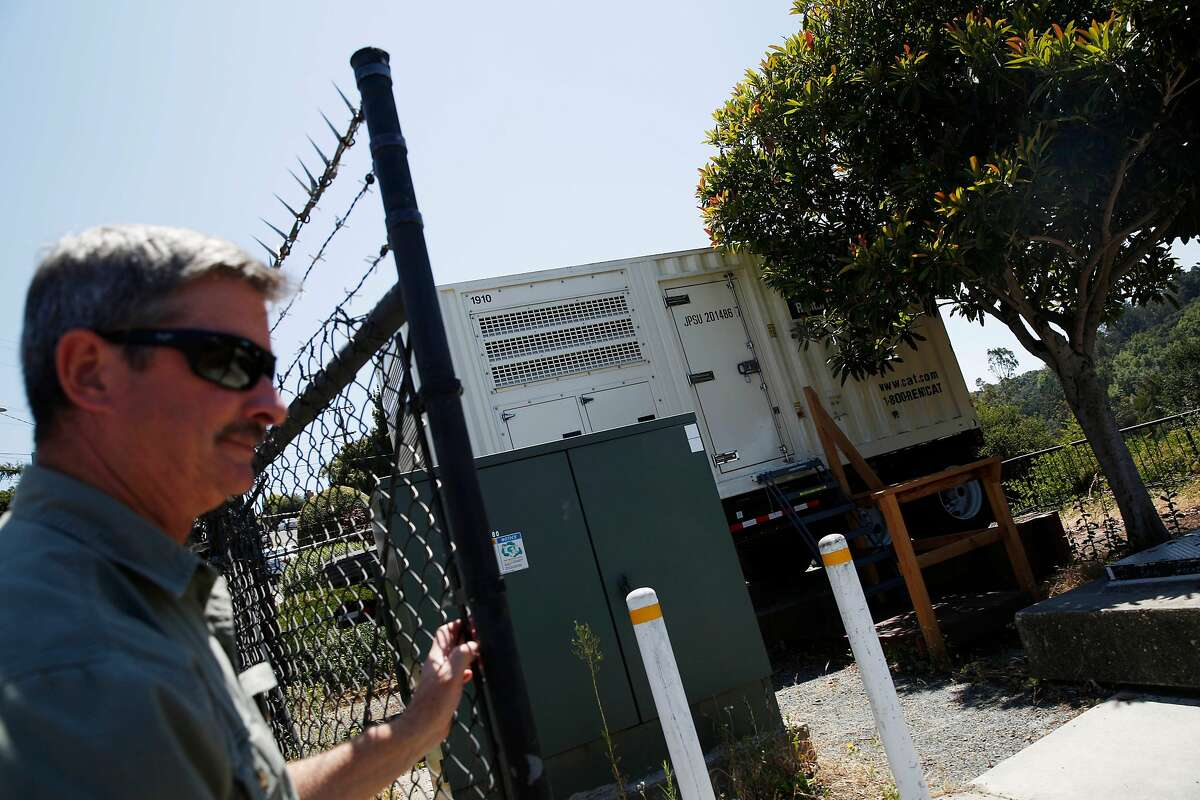 David Cherniss (l to r), East Bay Municipal Utility District mechanical supervisor opens a gate next to a portable generator at the Fontaine Pumping Plant on Friday, July 5, 2019 in Oakland, Calif.
