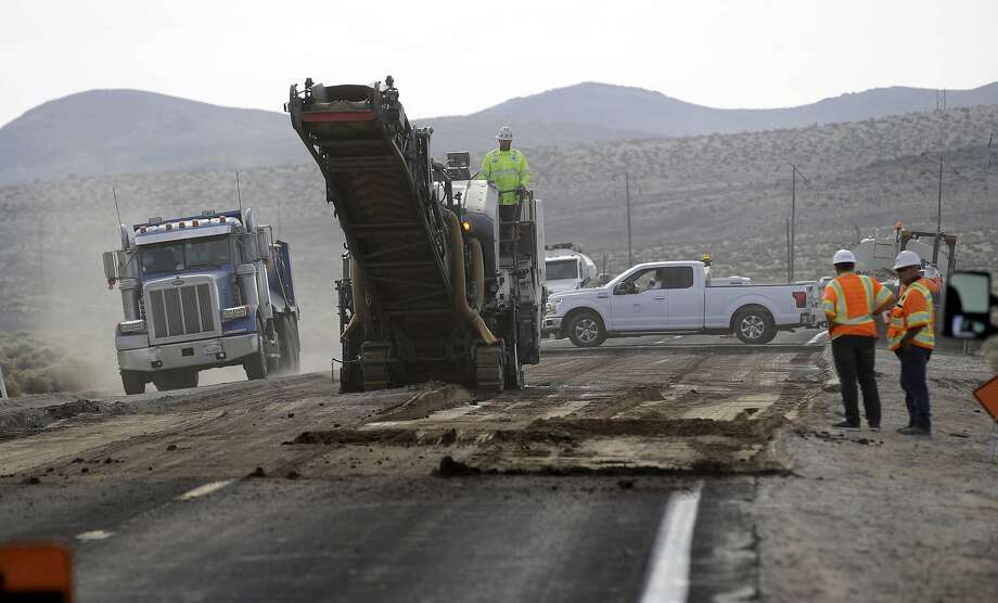Road crews work on repairing a section of State Route 178 Sunday near Trona (San Bernardino County) following the two earthquakes that hit last week. Photo: Marcio Jose Sanchez / Associated Press