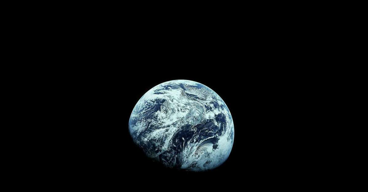 This photo provided by NASA shows Earth as seen from the Apollo 8 spacecraft, December 1968. A new generation of