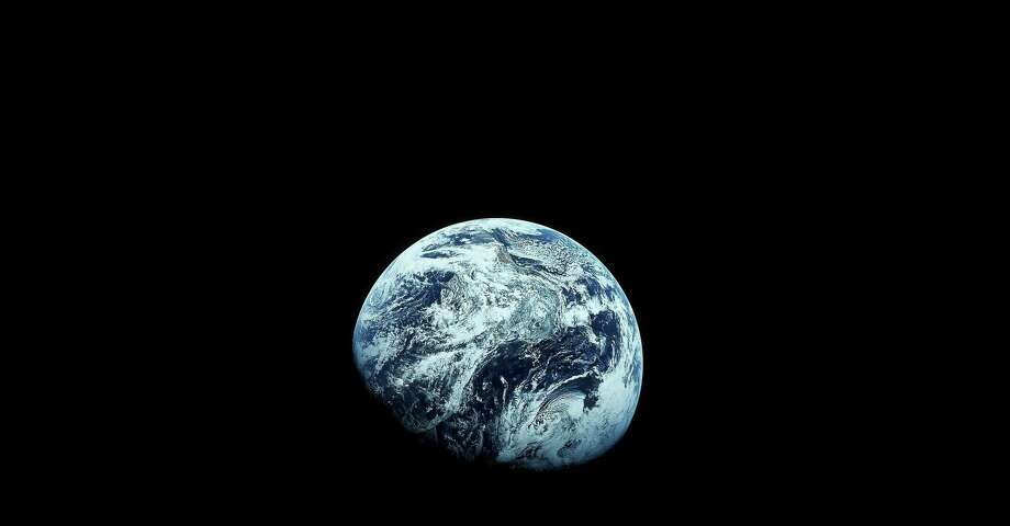 "This photo provided by NASA shows Earth as seen from the Apollo 8 spacecraft, December 1968. A new generation of ""flat Earthers"" has emerged — the cause is likely the easily accessible misinformation that's slung online. Photo: Uncredited /AP / AP1968"