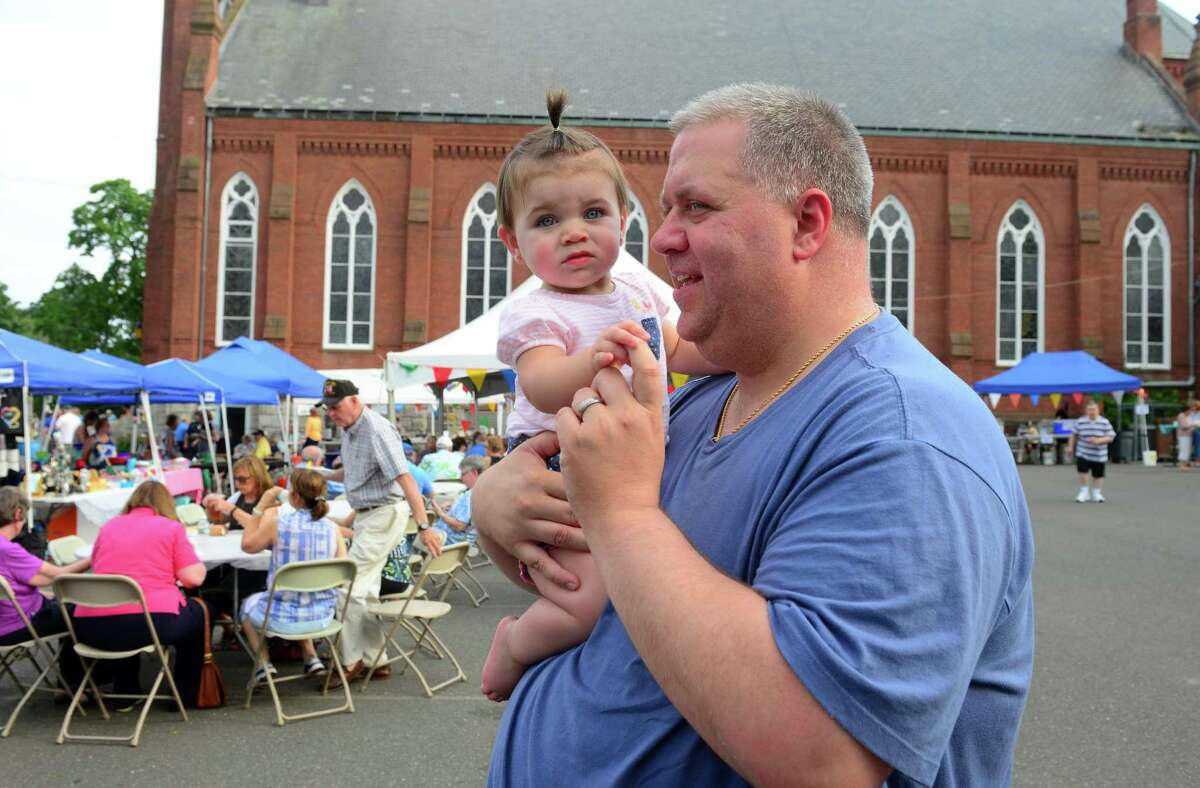 Eric Bonaiuto of Waterbury and his daughter Gabriella, 11 months, attend the last year's Summer Festival in Derby.