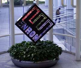 A revolving Enron Corp. logo seen in the lobby of the energy company's Houston headquarters in 2002