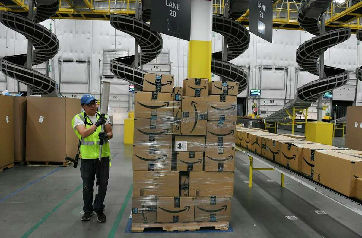 Prepping packages at an Amazon warehouse in Thornton, Colorado.