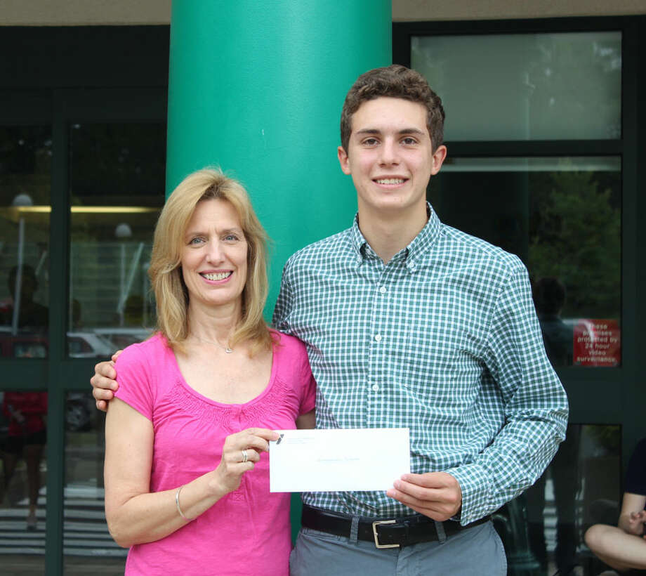 Mimi Conway, mother of Griffin Conway, presents the 2019 Griffin Conway Memorial Scholarship to Alessandro Sulpizi. New Canaan YMCA / Contributed photo / New Canaan Advertiser Contributed