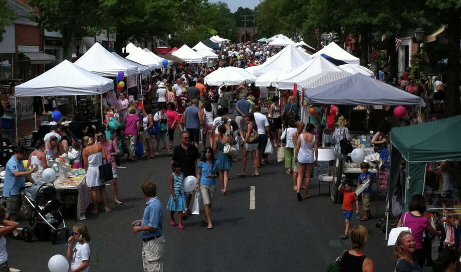 "New Canaan's 54th annual Village Fair and Sidewalk Sale will kick off on Friday, July 12, 2019, with local merchants bringing the bargains out on the sidewalks for all those ""early bird"" shoppers. Pictured is a previous Village Fair and Sidewalk Sale in New Canaan, Connecticut. Contributed photo"