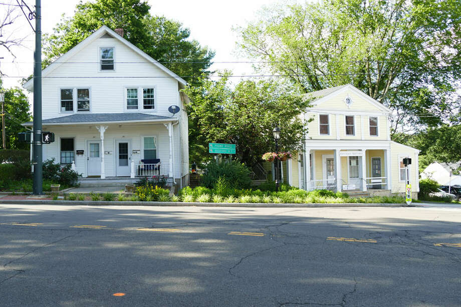 The Historic District Commission in New Canaan, Connecticut will look at increasing the size of the district. The Historic Commission is going to see if these two buildings on Main Street in New Canaan can become part of the Historic District along with Vine Cottage. The group agreed to look into it on June 27, 2019. Grace Duffield / Hearst Connecticut Media / Connecticut Post
