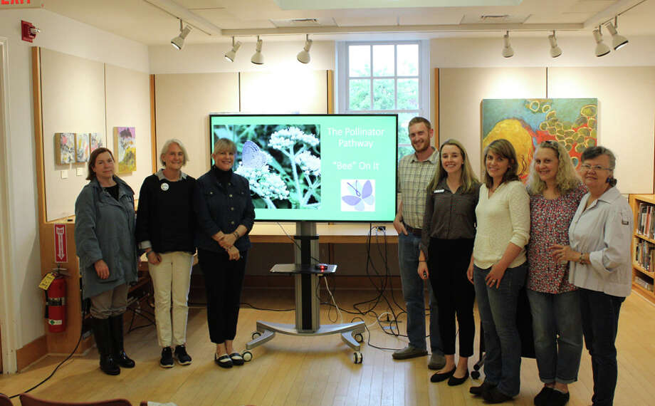 The New Canaan Library hosted a presentation to launch New Canaan's participation in the regional pollinator pathway on June 18. From left are Anda Hutchins of the New Canaan Garden Club; Mary Ellen Lamay, of the Hudson to Housatonic Regional Conservation Partnership, Louise Washer of the Norwalk River Watershed Association, Aaron Lefland of the New Canaan Land Trust, Kayla Del Biondo of the New Canaan Library, Robin Bates-Mason of Planet New Canaan, Betsy Sammarco of the New Canaan Beautification League, and Faith Kerchoff of the New Canaan Beautification League. / Connecticut Post