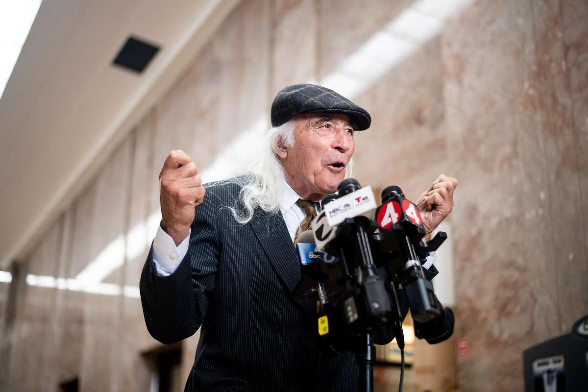FILE - Tony Serra, defense attorney for Ghost Ship warehouse master tenant Derick Almena, speaks with reporters at the René C. Davidson Courthouse in Oakland in this July 8, 2019 file photo. Almena faces involuntary manslaughter charges stemming from the 2016 blaze that killed 36 people during a music show.Serra told reporters why three jurors were removed from the jury on the trial in August after the Sept. 5 conclusion of the trial.