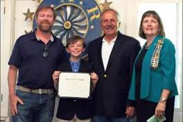 The N.E. Division CTDAR Awards Ceremony at Matthies Hall in Windsor, CT are Jay Eldredge, Brady's father who coincidentally won honorable mention in the 1983 DAR Essay Contest when he participated as a Hindley fifth grader, with N.E. Division Winner, Brady Eldredge; and Brady's grandfather, John Russo with Darien's Good Wife's River Chapter DAR Honorary Regent and CTDAR Treasurer, Katherine Love.