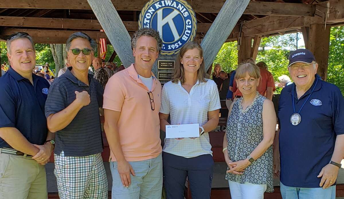 At the check presentation are, from left, Kiwanis member Jeff Turner; Kiwanis Vice President Greg Chann; John Priest, director of programing at Trackside; Cindy Moser ,Trackside director of development and operations, Mary Anne Franco, Kiwanis vice president; and Kiwanis president Jack McFadden.