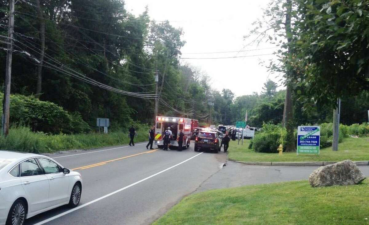 Traffic backed up on Route 7 in Ridgefield early Sunday morning after a naked man from New York jumped into the back of a pickup truck. The man later jumped from the truck while it was moving, resulting in significant head injuries. - Susan Schultz/Hearst Connecticut Media photo