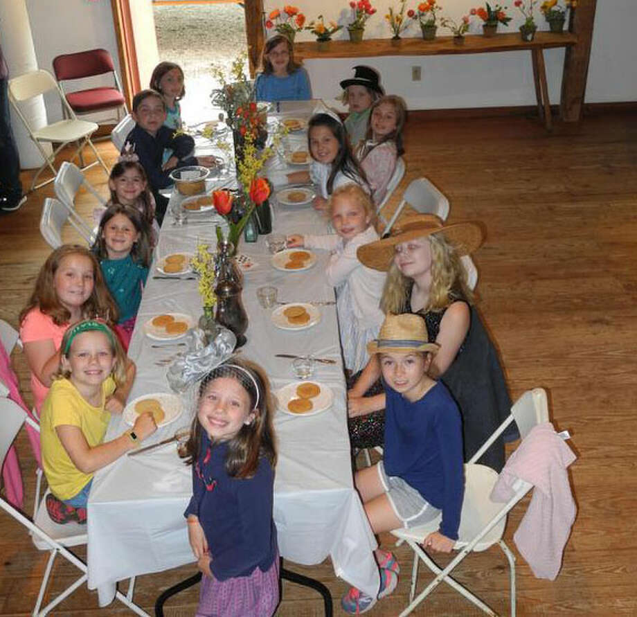 Fourteen boys and girls celebrated the end of the school year with a Mad Hatter's tea party at the Wilton Historical Society on June 13. — Contributed photo / Wilton Bulletin