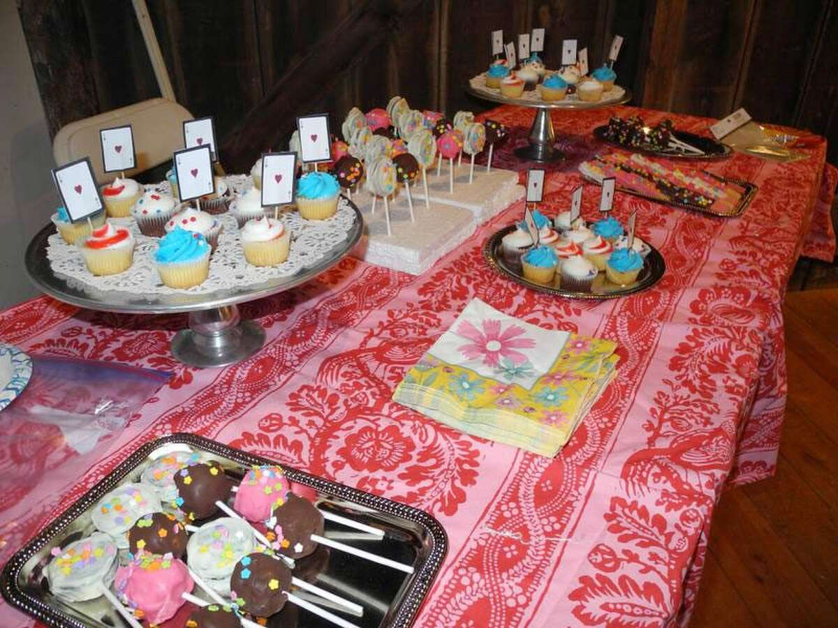 An array of goodies, including cakes and candies, awaited guests at the Wilton Historical Society's Mad Hatter Tea Party. - Contributed photo