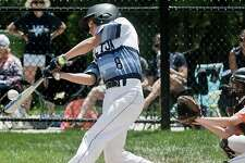 Tanner Schmauch connects with a pitch during Wilton's district tourney opener against Ridgefield. - Scott Mullin photo