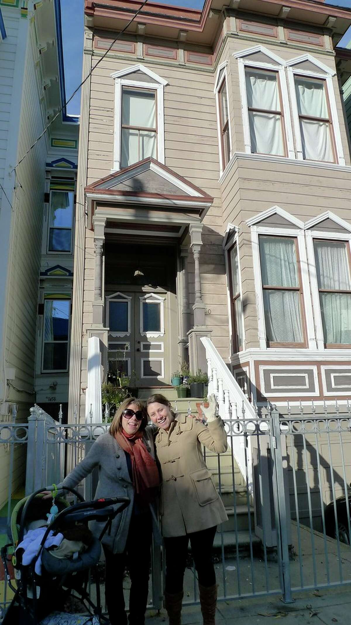 Me (in sunglasses), my sister and my then-infant son shortly before taking possession of the property.