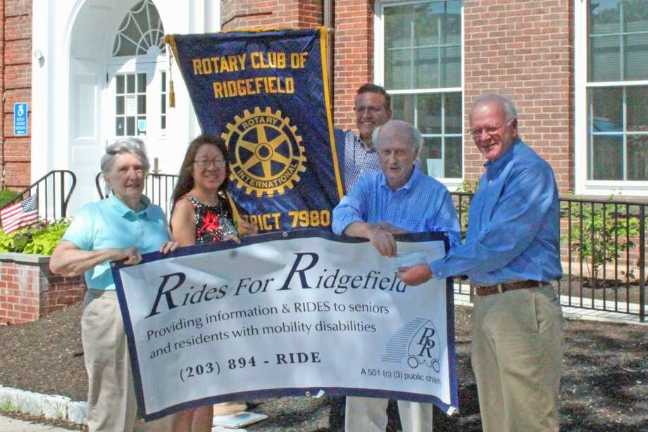 From left to right: Margaret Thompson, Nancy Brandon, David Yagnesak and Dave Smith of Rides for Ridgefield presented donation by Joe Cleary of the Rotary Club of Ridgefield.