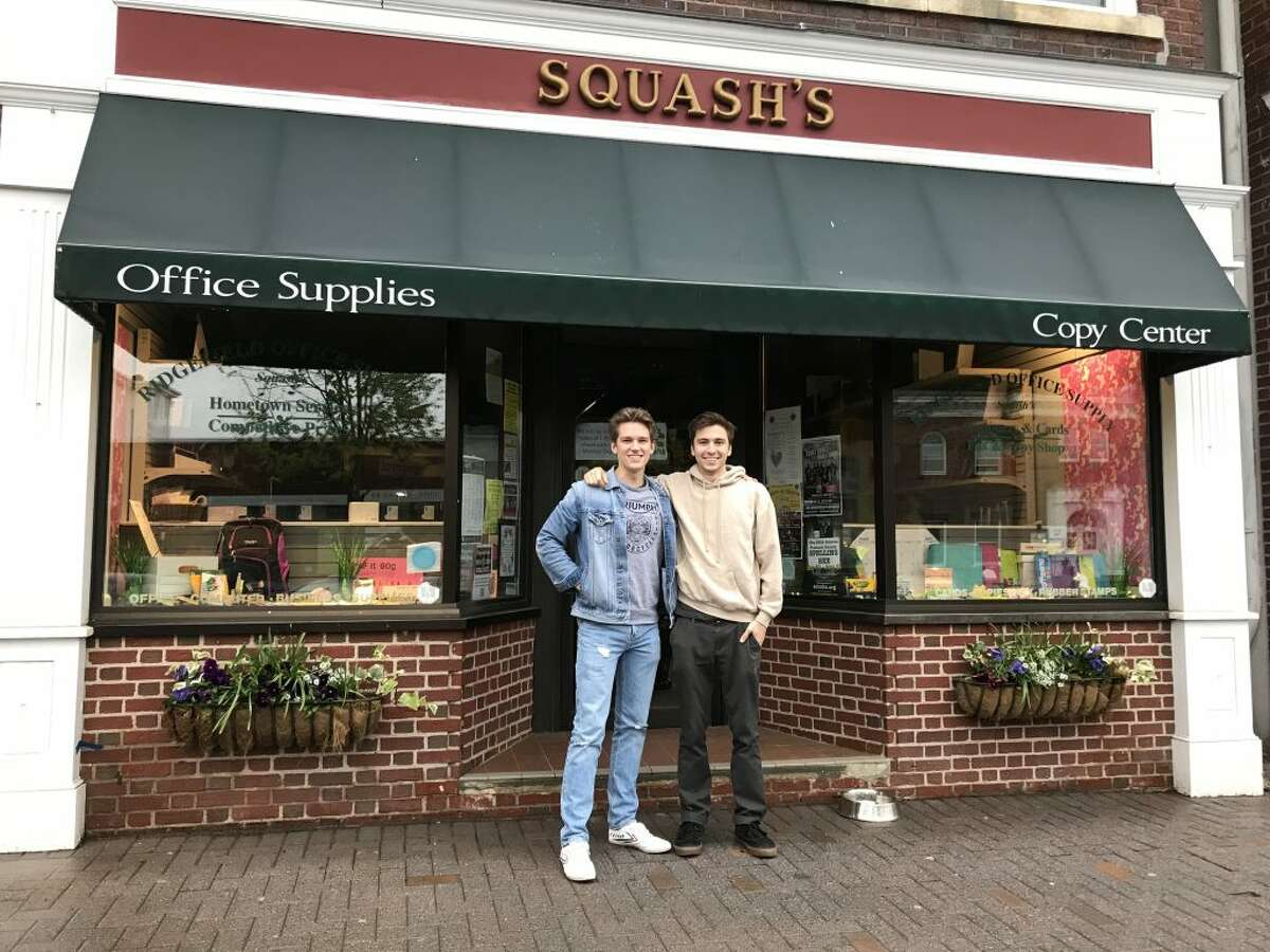 Filmmakers Nick Freeman and Dion White in front of Squash's.