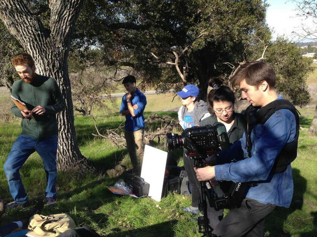 Outdoor shooting is a group effort of the filmmakers on the set of