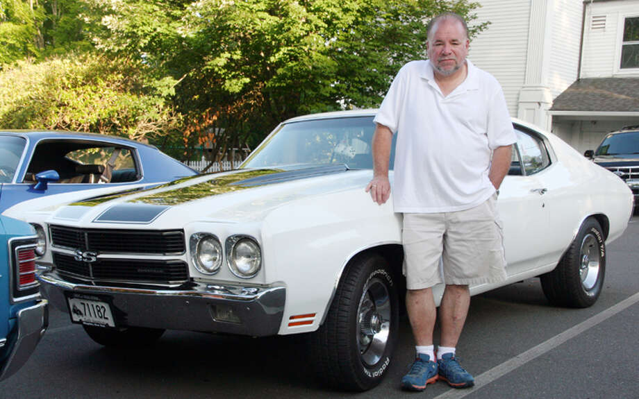 Memory Lane Cruisers member David Coles with his 1970 Chevrolet Chevelle. —Nicholas Martinez photo