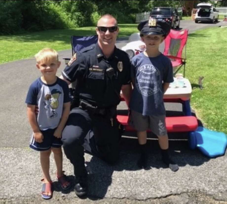 Officer Michael McKnight stopped by Connor and Nolan's lemonade stand to enjoy some ice cold lemonade in late June. The stand was set up to raise money for the Ridgefield Police Department. The two Ridgefield boys were selling it $.50 a glass.