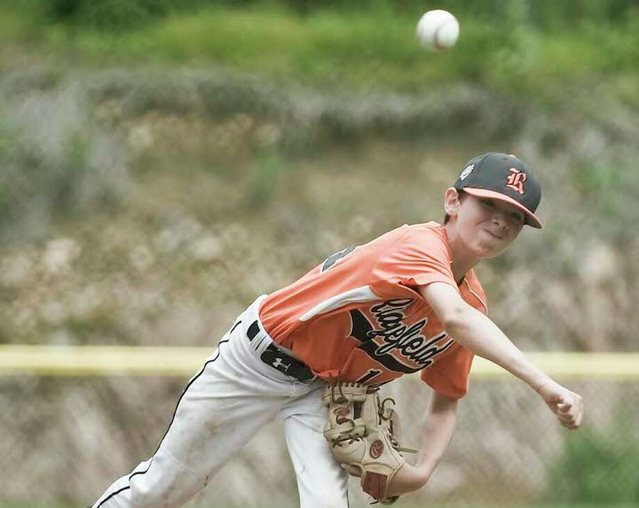 Chris Keating throws a pitch in Ridgefield's District 1 tournament game against Wilton. — Scott Mullin photo / Scott Mullin ownership