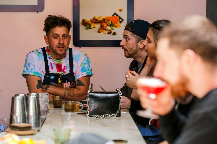 Nicolas Torres talks with customers Daniel Kutch and Robyn Katz of San Francisco at True Laurel Sunday, July 7, 2019, in San Francisco, Calif. Photo: Josie Norris / The Chronicle