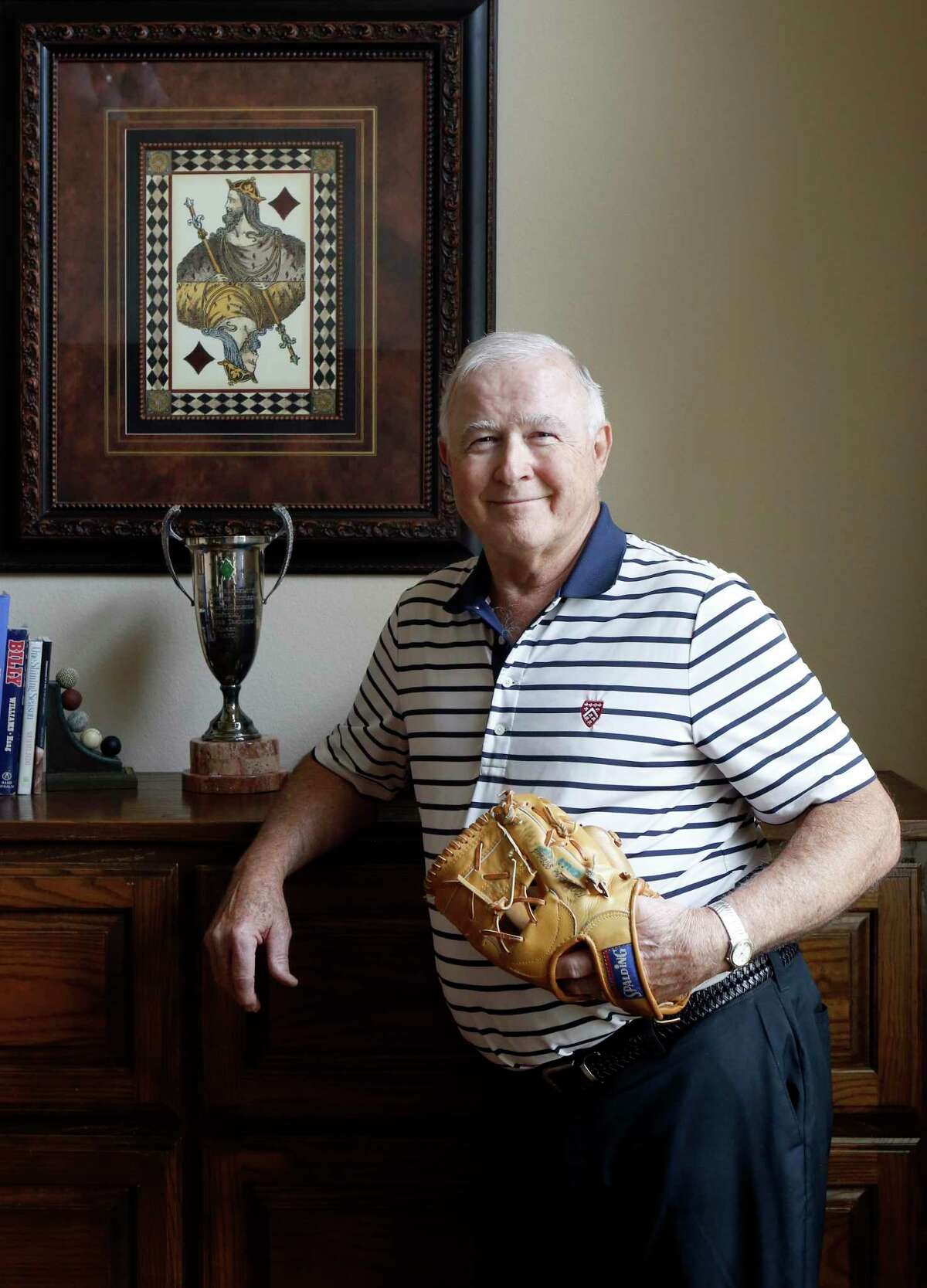 """Former Major League Baseball player Billy Grabarkewitz, with a baseball glove he played with and a trophy for """"the player that most exemplifies Dodgers tradition,"""" at his home in Colleyville, Texas on Friday, June 14, 2019. Grabarkewitz looks back at the 1970 All-Star Game, which amazingly included three players from San Antonio. (photo by Lara Solt )"""