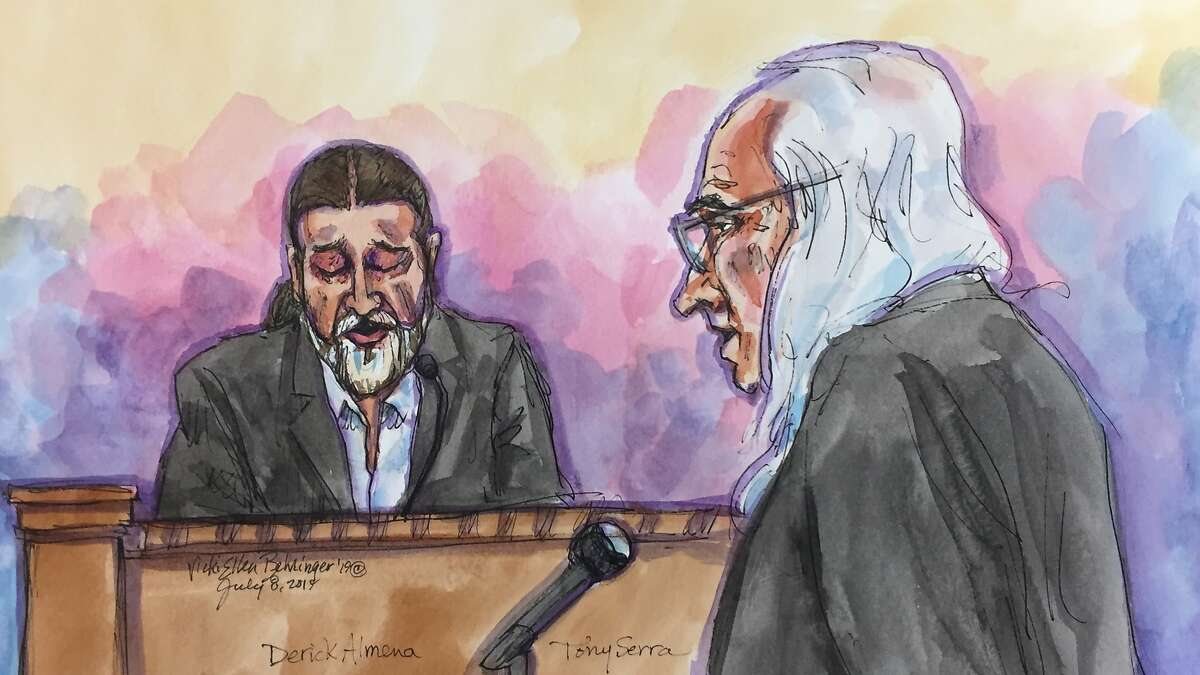 Derick Almena, left, answers questions from his defense attorney Tony Serra at the Rene C. Davidson Courthouse in Oakland, Calif., on Monday, July 8, 2019. Almena faces involuntary manslaughter charges stemming from the 2016 blaze that killed 36 people during a music show.