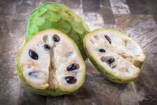 #1. Cherimoya (raw) - Nutritional fitness score: 0.96 - Known for being: Rich in carbohydrates - Price per 100 grams: $1.84 Grown in various tropical regions, cherimoya, commonly known as custard apple, looks like pineapple but has a creamy, custardy texture and sweet flavor. Cherimoya is full of antioxidants, vitamin C, and vitamin B6. While the fruit has many health benefits, the skin and seeds should be discarded before eating, as they contain annonacin, a toxin that can affect the brain and nervous system in high doses. This slideshow was first published on theStacker.com