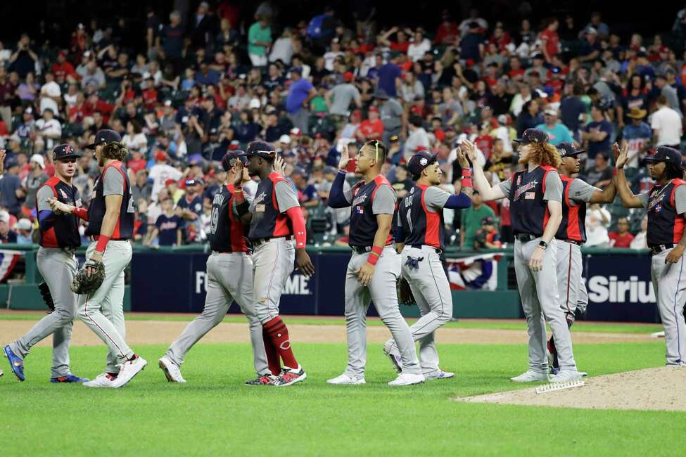 The National League players react the MLB All-Star Futures baseball game, Sunday, July 7, 2019, in Cleveland. The 90th MLB baseball All-Star Game will be played Tuesday. The game against the American League ended 2-2. (AP Photo/Darron Cummings)