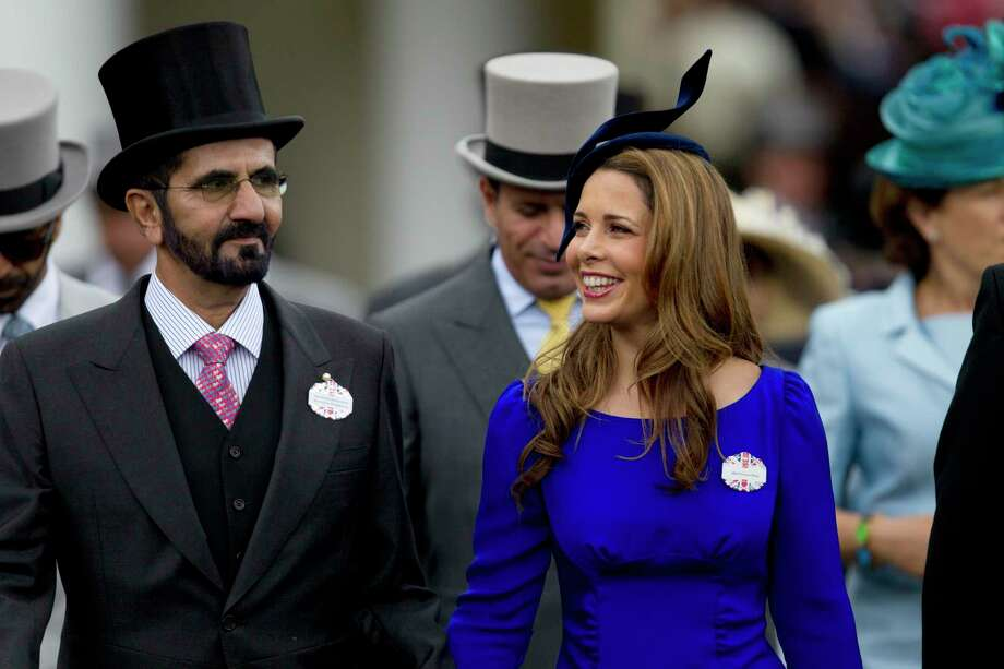 In this Wednesday, June 20, 2012 file photo, Sheikh Mohammed Al Maktoum and his wife Princess Haya of Jordan walk towards the paddock on the second day of Royal Ascot horse race meeting at Ascot, England. A legal battle between the powerful, poetry-writing ruler of Dubai and his wealthy estranged wife is leading toward a showdown in a London courtroom later this month. The family division court case scheduled on July 30 pits Sheikh Mohammed bin Rashid Al Maktoum against Princess Haya, daughter of the late King Hussain of Jordan and an accomplished Olympic equestrian on friendly terms with horse aficionado Queen Elizabeth II. Photo: Alastair Grant, STF / Associated Press / Copyright 2019 The Associated Press. All rights reserved.