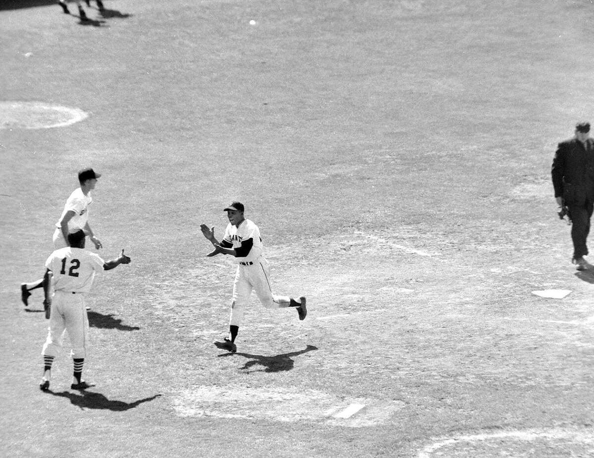SPECIAL TO SAN FRANCISCO CHRONICLE--FILE--It's a hand-clapping, happy, Willie Mays of the San Francisco Giants who has just crossed home plate in the 10th inning to give the National League a 5 to 4 win over the American League in the All-Star game in San Francisco's Candlestick Park July 11, 1961. Waiting to greet Mays is Bill White (12) of the St. Louis Cards. Mays got on base with a double and scored on a single by Roberto Clemente of the Reds. (AP photo/stf) Ran on: 07-09-2007 The air was filled with anticipation -- and plenty of wind -- as balloons were released during pregame ceremonies at Candlestick in 1984.