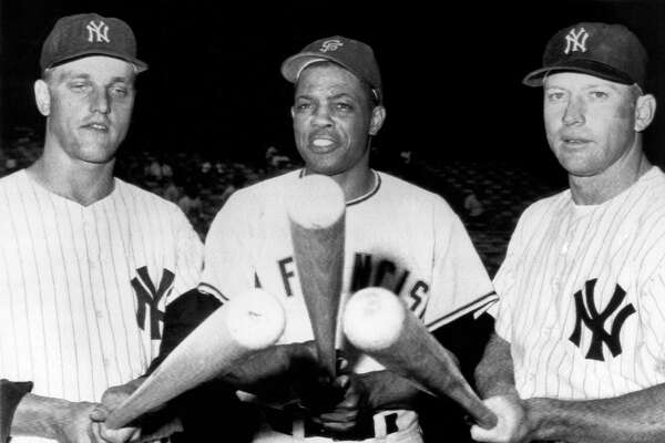 Slugging outfielders before an exhibition game at Yankee Stadium. L-R, Roger Maris, Yankees, Willie Mays, Giants, and Mickey Mantle, Yankees. New York, New York, July 24, 1961. (Photo by Underwood Archives/Getty Images)