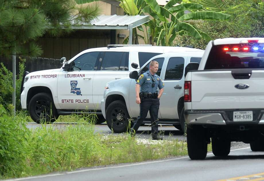 Police officials block an area of River's Edge Road in West Lake, Louisiana Monday after a car chase that began in Jefferson County. Photo taken Monday, 7/8/19 Photo: Guiseppe Barranco/The Enterprise, Photo Editor / Guiseppe Barranco ©