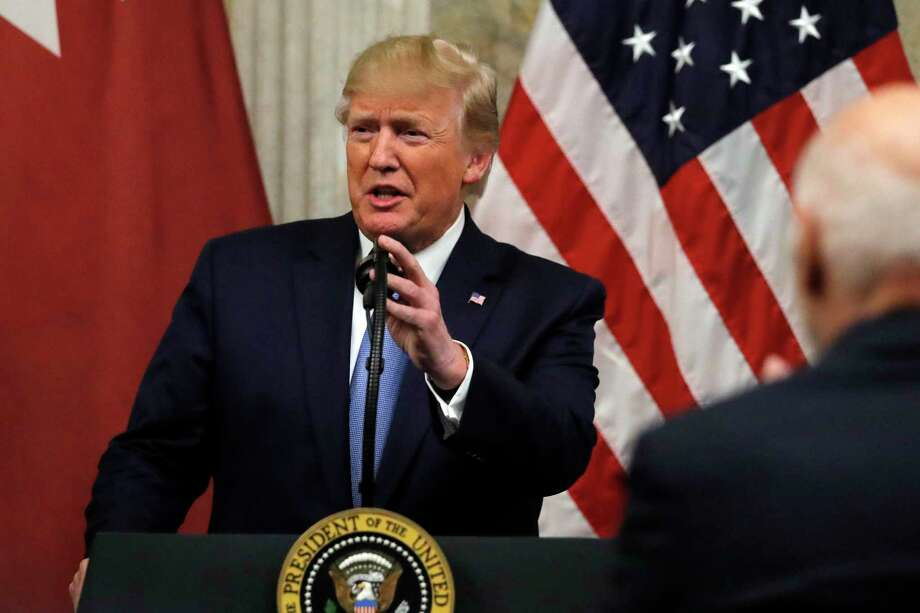 President Donald Trump speaks as he attends a dinner hosted by the Treasury Secretary Steven Mnuchin in honor of the Qatar's Emir Sheikh Tamim bin Hamad Al Thani at the Treasury Department in Washington, Monday, July 8, 2019. (AP Photo/Carolyn Kaster) Photo: Carolyn Kaster, STF / Associated Press / Copyright 2019 The Associated Press. All rights reserved