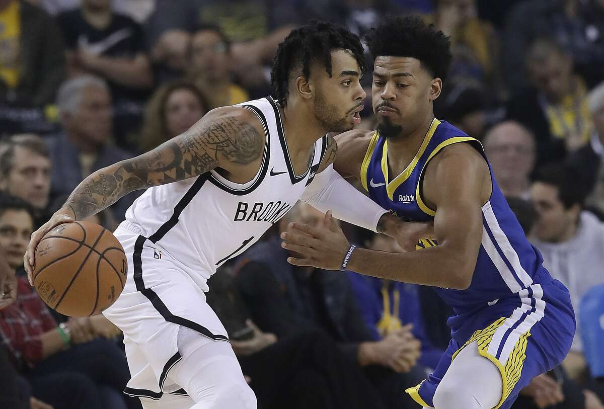FILE - Brooklyn Nets guard D'Angelo Russell, left, drives against Golden State Warriors guard Quinn Cook during the first half of an NBA basketball game in Oakland, Calif., Saturday, Nov. 10, 2018.