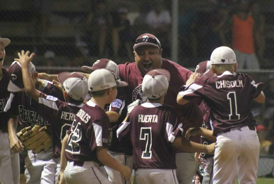 The celebration is on for the coaches and players after Oscar Medina struck out the last batter, stranding the tying run on second base. Photo: Robert Avery