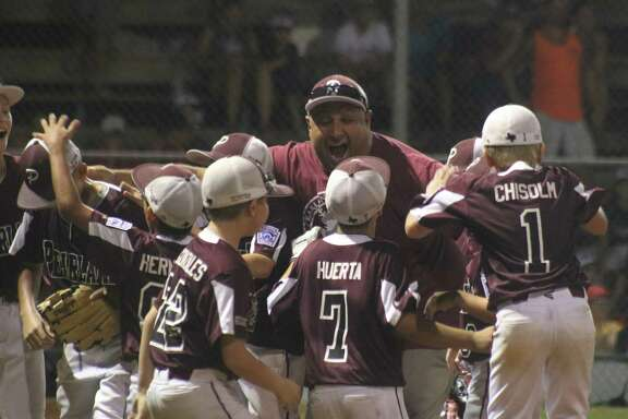 The celebration is on for the coaches and players after Oscar Medina struck out the last batter, stranding the tying run on second base.
